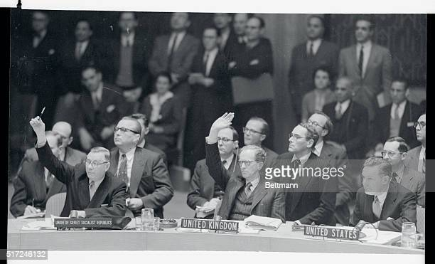 Soviet Delegate Arkady A Sobolev and sir Pierson Dixon of England vote for the admission of Outer Mongolia as the U S Delegate Henry Cabot Lodge Jr...