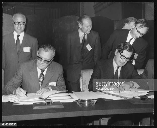 Soviet Deputy Prime Minister Vladimir Kirillin and British Secretary of State for the Environment Anthony Crossland sign the AngloSoviet Agreement on...