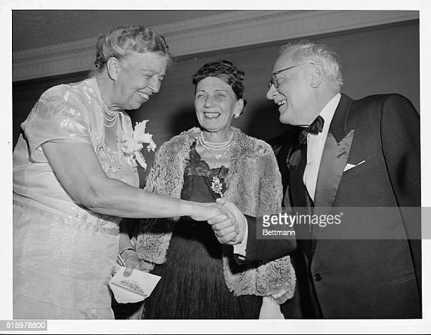 Soviet diplomat Andrei Vishinsky extends a hand of congratulation to Eleanor Roosevelt during a dinner at the Hotel Roosevelt honoring Mrs Roosevelt...