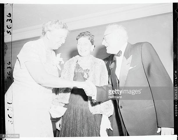 Soviet diplomat Andrei Vishinsky extends a hand of congratulation to Mrs Franklin D Roosevelt during a dinner at the Hotel Roosevelt tonight honoring...