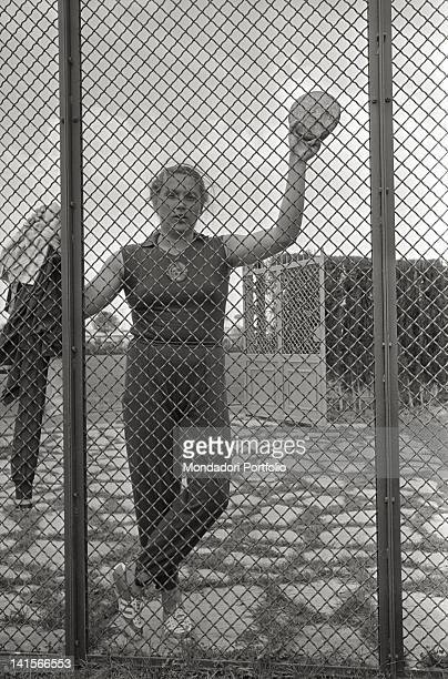 Soviet discus thrower Tamara Press posing behind a metallic net at the Rome Olympic Games Rome 1960