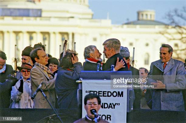 Soviet dissident Vladimir Slepak and American politician US Representative Jack Kemp embrace at the podium during at the Campaign to the Summit,...