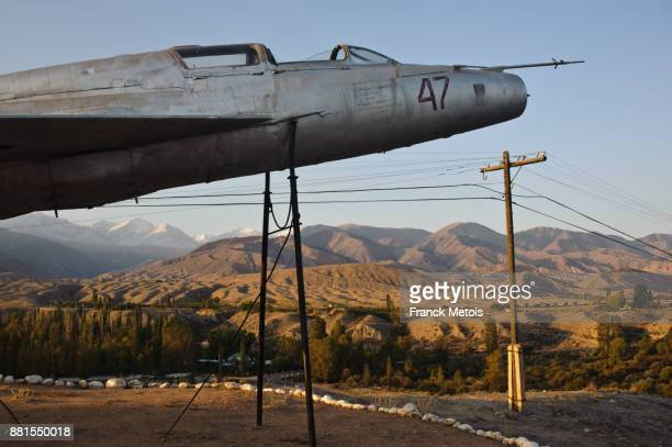 soviet era plane on a plinth ( kyrgyzstan) - former soviet union stock pictures, royalty-free photos & images
