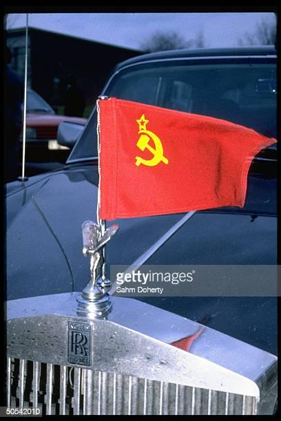 Soviet flag flying fr. Rolls Royce auto during visit fr. Soviet Politburo member Mikhail Gorbachev