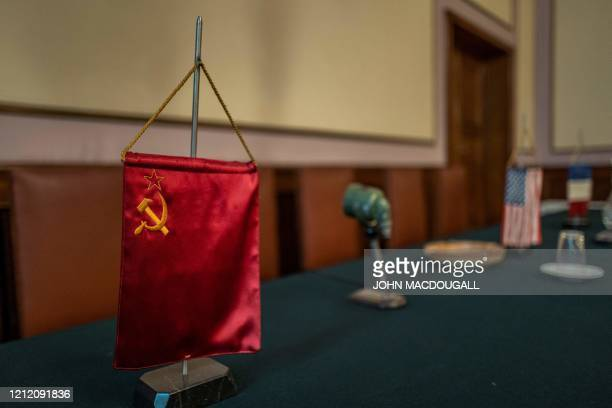 A Soviet flag marks the seat of the head of the Soviet delegation in the room in which the unconditional surrender of Nazi Germany was signed on May...