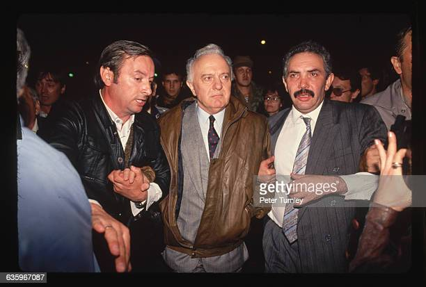 Soviet Foreign Minister Eduard on his way to the parliament building surrounded by his body guards after the failed coup attempt by communist hard...