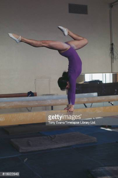 Soviet gymnast and Olympic gold medalist Nellie Kim performs on a balance beam 1976
