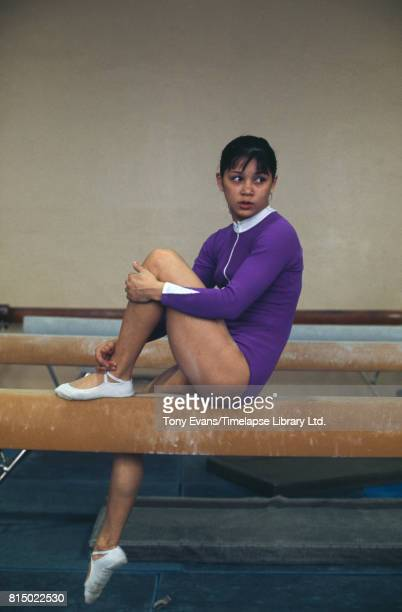 Soviet gymnast and Olympic gold medalist Nellie Kim poses on a balance beam 1976