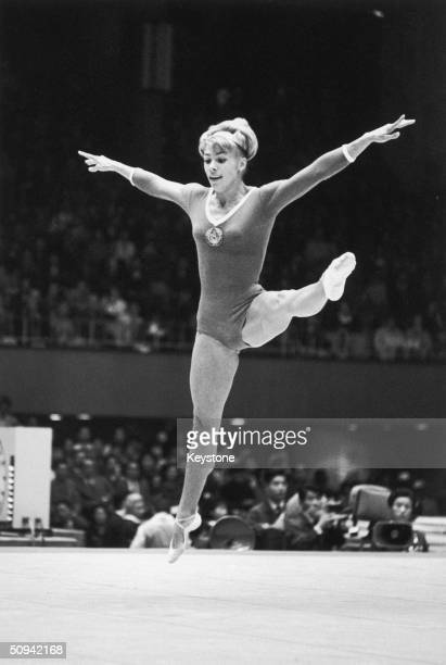 Soviet gymnast Larissa Latynina of the Ukraine in action during the women's compulsory exercises at the Tokyo Olympics October 1964
