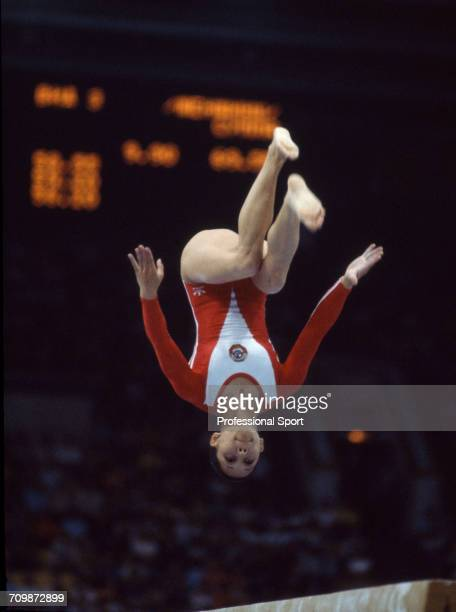 Soviet gymnast Nellie Kim pictured in action for the Soviet Union team on the balance beam during competition in the women's artistic team allaround...