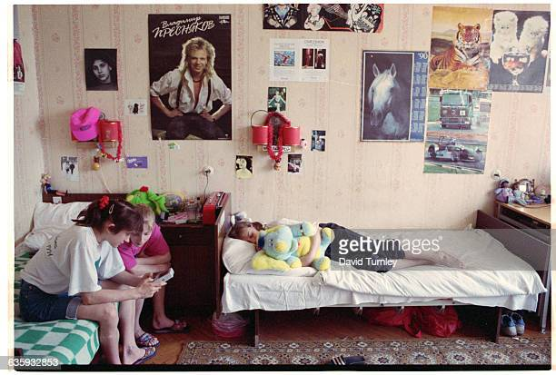 Soviet gymnasts relax in their dorm room at the Round Lake Sports Training Center near Moscow