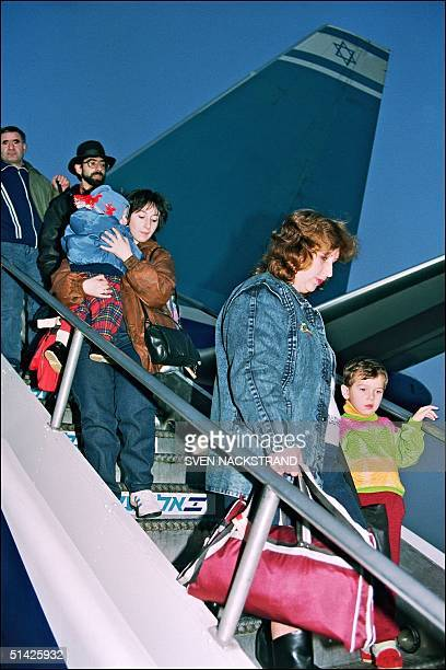Soviet Jews on the first direct ElAl flight carrying immigrants from Moscow disembark at the BenGurion airport in the morning 27 November 1991 The...