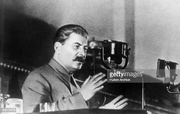 Soviet leader Joseph Stalin addressing the Extraordinary 8th All Union Congress of Soviets on the draft of the USSR's constitution