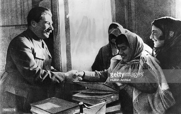 Soviet leader Joseph Stalin meets women delegates from the Workers of Soviet Armenia at the commemoration of the 15th anniversary of the...