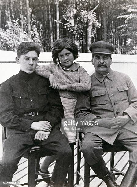 Soviet leader Joseph Stalin with his son Vasily and daughter Svetlana at one of Stalin's dachas former Soviet Union June 1935 Both children are by...