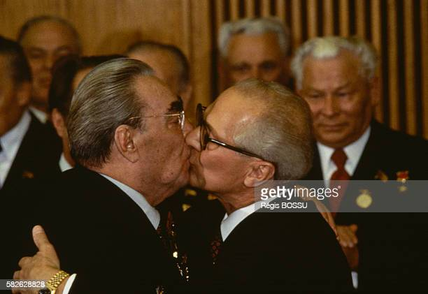 Soviet leader Leonid Brezhnev and East German President Erich Honecker kiss on the occasion of GDR's 30th anniversary