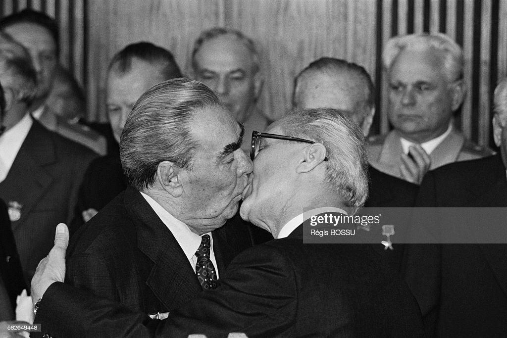 Kiss of Soviet Leader Brezhnev and East German President Honecker : News Photo