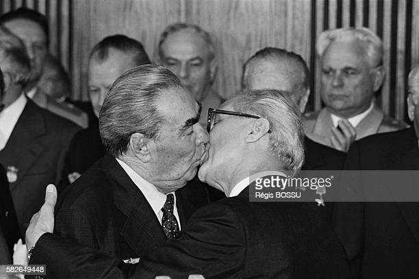 Soviet leader Leonid Brezhnev and East German President Erich Honecker kiss on the occasion of the 30th anniversary of the German Democratic Republics