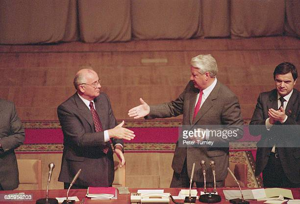 Soviet leader Mikhail Gorbachev and Boris Yeltsin shake hands during a meeting after the failed coup d'etat in 1991.