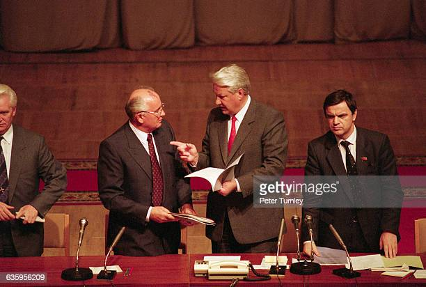 Soviet leader Mikhail Gorbachev and Boris Yeltsin talk with each other during a meeting after the failed coup d'etat in 1991