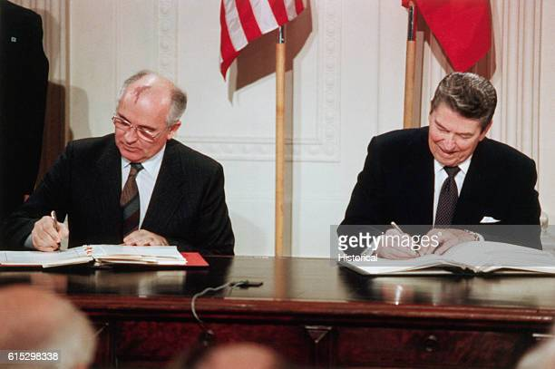 Soviet Leader Mikhail Gorbachev and President Ronald Reagan sign the Intermediaterange Nuclear Forces agreement in the East Room of the White House...
