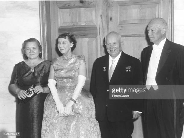Soviet leader Nikita Khrushchev and his wife Nina Khrushcheva poase with US President Dwight Eisenhower and his wife First Lady Mamie Eisenhower...