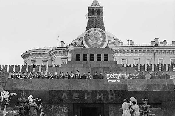 Soviet leaders including Leonid Brezhnev and Alexei Kosygin review the 1966 May Day parade from the rostrum of the Tomb of Lenin in Moscow