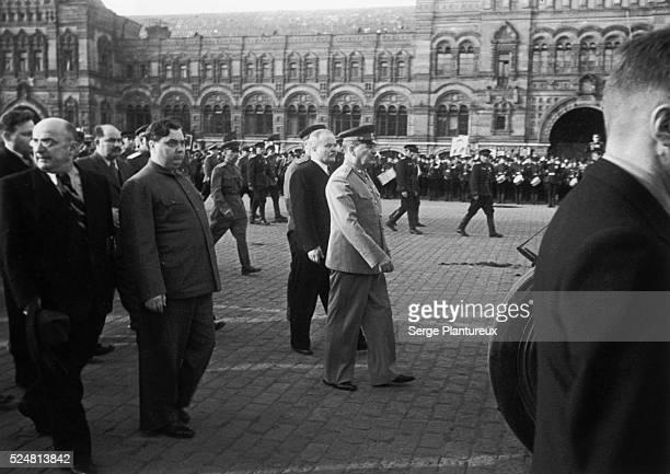 Soviet leaders Lavernty Beria Georgi Malenkov Vyacheslav Molotov and Josef Stalin cross Red Square after taking Mikhail Kalinin's coffin to the...