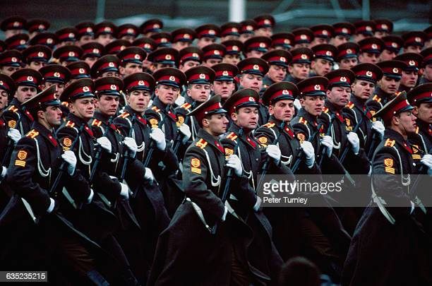 Soviet military men march in formation during a parade commemorating the 73rd anniversary of the Russian Revolution