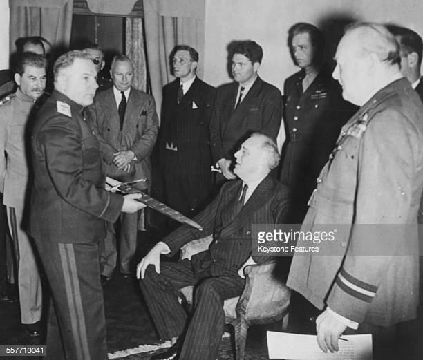 Soviet military officer Kliment Voroshilov showing the Stalingrad sword to US President Franklin D Roosevelt watched by British Prime Minister...