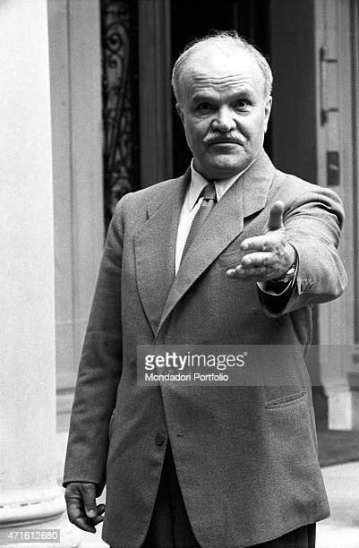 Soviet Minister of Foreign Affairs Vyacheslav Molotov gesticulating toward the photographer at the Geneva Summit discussing issues about security...
