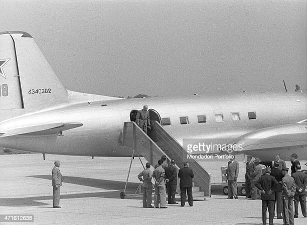 Soviet Minister of Foreign Affairs Vyacheslav Molotov walking down the airplane ladder at the airport He's going to take part in the Geneva Summit...