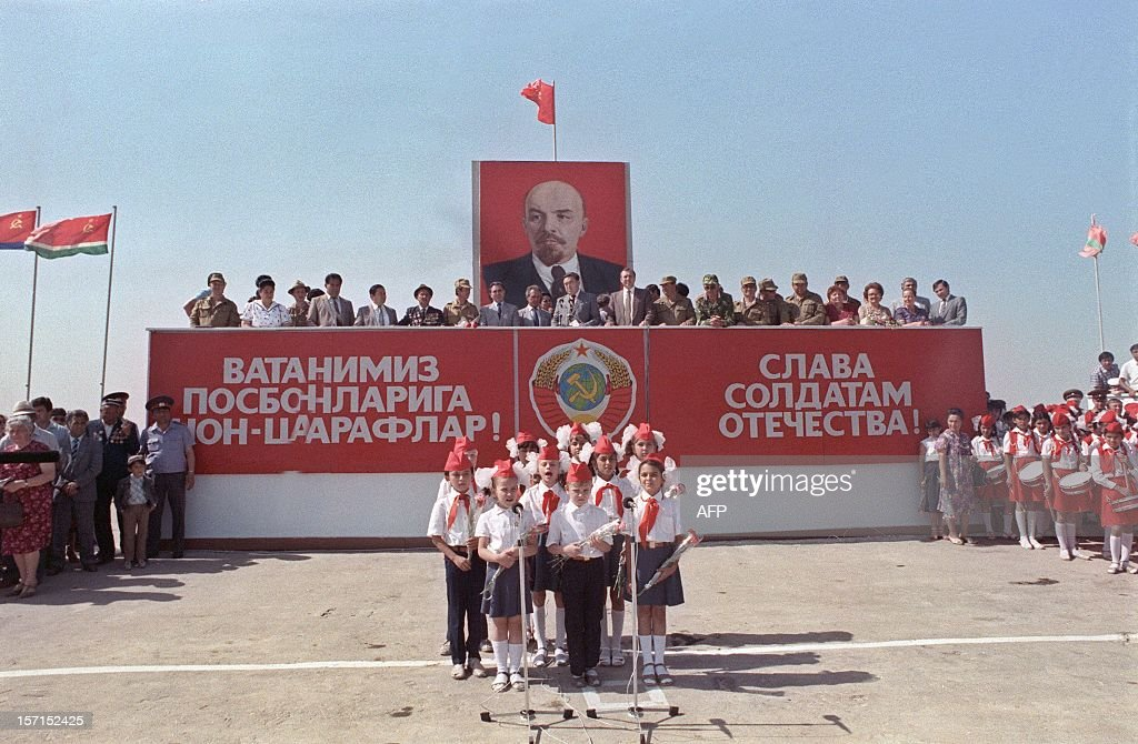 Soviet officials celebrate, under a huge portrait of Lenin, on May 21, 1988, in Termez, at the Soviet-Afghan border, the withdrawal of the Red Army from Afghanistan. The banner on the right reads: 'Glory to our land soldiers'.... The Soviet war in Afghanistan, also known as the Soviet-Afghan War, was a nine-year conflict involving Soviet forces supporting the Marxist People's Democratic Party of Afghanistan (PDPA) government against the Mujahideen resistance. The initial Soviet deployment of the 40th Army in Afghanistan began on August 7, 1978. The final troop withdrawal began on May 15, 1988, and ended on February 15, 1989.