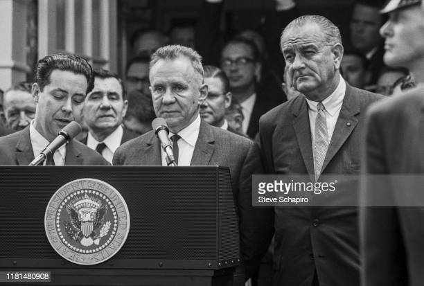Soviet Premier Alexei Kosygin and American President Lyndon Johnson stand at a podium during the Glassboro Summit Conference, on the campus of...