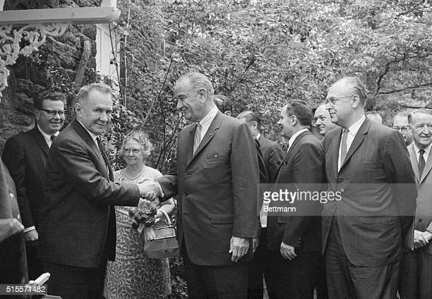 Soviet premier Alexi Kosygin shakes hands with President Johnson as New Jersey Governor stands watches | Location Glassboro State College Glassboro...