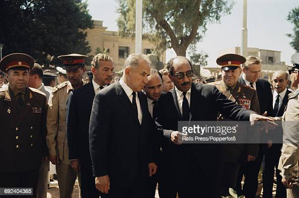 Soviet Premier and statesman Alexei Kosygin on left and President Anwar Sadat of Egypt stand together in front of the tomb of former Egyptian...