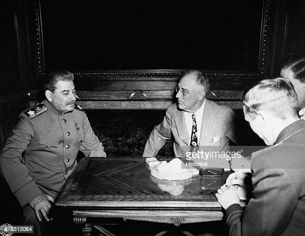 Soviet premier Joseph Stalin and US President Franklin D Roosevelt talk during the Yalta Conference of 1945 Roosevelt Stalin and Winston Churchill of...