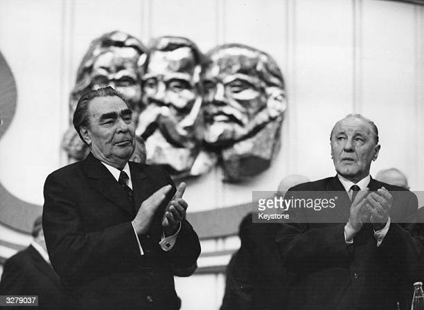 Soviet premier Leonid I Brezhnev stands with Janos Kadar on the first day of the 11th Congress of the Hungarian Socialist Workers' party in...