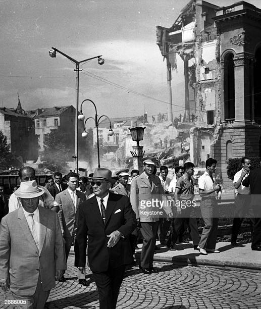 Soviet premier Nikita Khrushchev and Yugoslavian president Josip Broz Tito in front of the shattered Army Club in Skopje, Yugoslavia, during their...