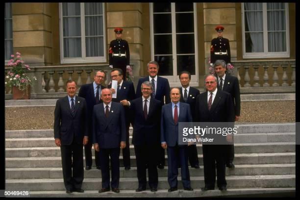 Soviet Pres Gorbachev posing w Group of 7 ldrs Lubbers Kohl Kaifu Mitterrand Mulroney Major Andreotti Delors Bush