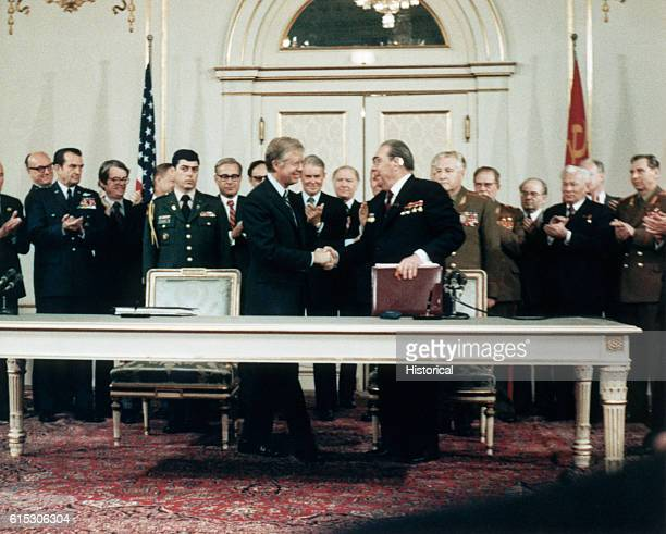 Soviet President Leonid Brezhnev and US President Jimmy Carter shake hands after signing the strategic arms limitation treaty Vienna Austria June 18...