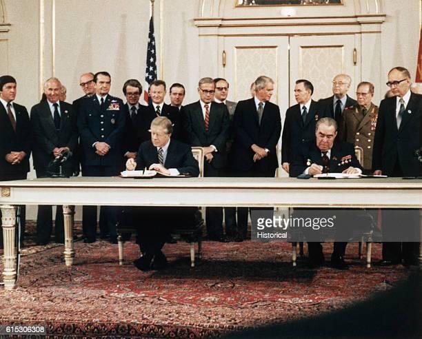 Soviet President Leonid Brezhnev and US President Jimmy Carter sign the strategic arms limitation treaty Vienna Austria June 18 1979