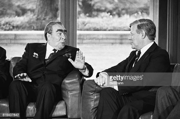 Soviet President Leonid Brezhnev and West German Chancellor Helmut Schmidt meet in Bonn.