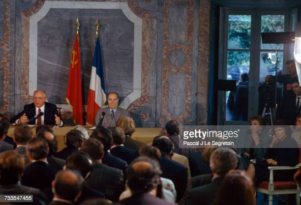Soviet president Mikhail Gorbachev and French president Francois Mitterand hold a press conference in Rambouillet France Their wives Raisa and...