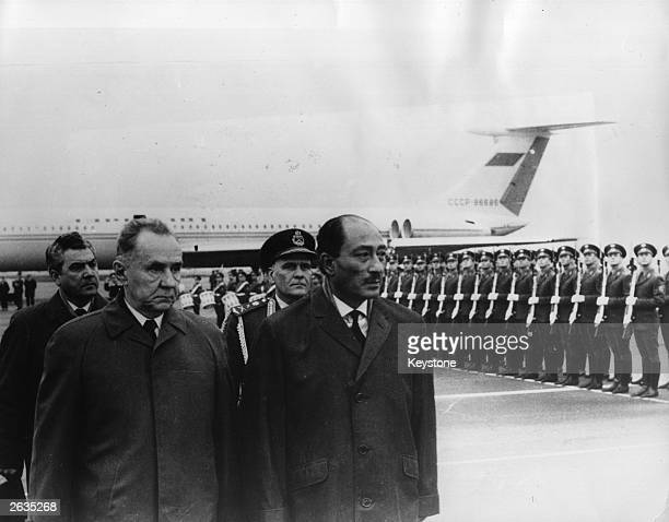 Soviet Prime Minister Alexey Nikolayevich Kosygin and Egyptian Prime Minister Mohammed Anwar al Sadat inspect the guard of honour on Sadat's arrival...