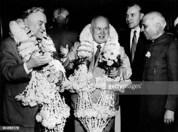 Soviet Prime minister Nikolai Bulganin and Soviet communist leader Nikita Khrushchev wearing garland are welcomed by Indian Prime minister Jawaharlal...