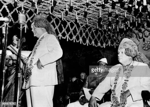 Soviet Prime minister Nikolai Bulganin flanked by Soviet communist leader Nikita Khrushchev wearing the traditional turban from Rajasthan delivers a...