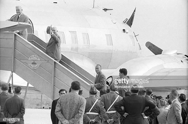 Soviet Prime Minister Nikolai Bulganin getting on a Pilatus Aircraft airplane followed by the first secretary of CPSU Nikita Khrushchev during the...