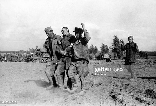 Soviet prisoners of war are presumably being taken to a POW camp by the German invaders 1940s