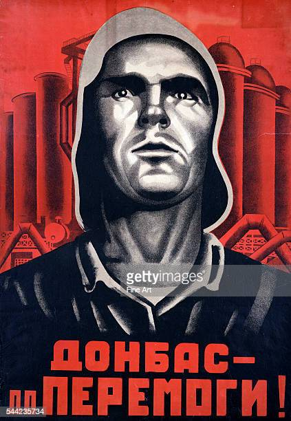 Soviet propaganda poster by an unknown artist entitled 'Donbas' showing the face of a factory worker in front of factory buildings in the Ukraine...